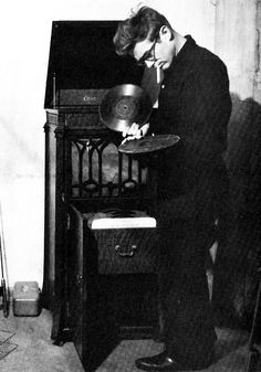 See the victrola?  We played my Grandmother's in the 1940's and 1950's.  Keeping needles for it was difficult after WWII.  It also had 2 or 3 marionettes that would set the spindle and dance after we cranked the handle and got the revolutions going.