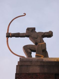 East Finchley tube station is marked by a statue of an archer by Eric Aumonier in the Art Deco style, and pointing his arrow towards the opening of the tunnel running to the Southern end of the Northern Line at Morden. This 17.3 miles (27.8 km) long tunnel was for many years the longest in the world.