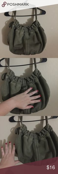 Old Navy large canvas handbag green See in pic the black stains. Inside has minor black spots to. Otherwise very spacey. Great sturdy material, thick bag. Has white stitching and string ties on side for decoration, SEE PIC PLEASE. Old Navy Bags Shoulder Bags