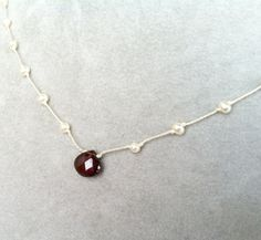 Hey, I found this really awesome Etsy listing at http://www.etsy.com/listing/126511918/faceted-garnet-and-pearl-necklace-hand
