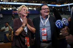 Actors Patricia Arquette, left, and Wayne Knight talk to reporters on the floor of #DNC2012 in Charlotte, N.C., on Wednesday. (Photo: Jae C. Hong / AP) #NBCPolitics