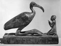 Group statue of Thoth-ibis and devotee on a base inscribed for Padihorsiese.  Period:     Late Period. Dynasty:     Dynasty 26. Date:     ca. 700–500 B.C.