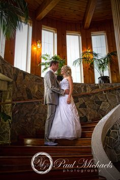 Bride and groom on the stairs at Wallaceville house. PaulMichaels Wellington wedding photography http://www.paulmichaels.co.nz/