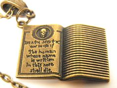 """Handcrafted Death Note Bronze Book Pendant Necklace on Bronze Chain with Lobster Claw Clasp. Pendant is approximately 1 1/4"""" x 1"""" inches. (33x25mm) Pendant is Bronze Tone Pewter. Written on Pendant: """"Death Note How to Use It: The Human Who's Name is Written Here Shall Die.""""  by MelancholyMind"""