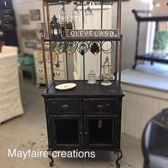 Mayfaire Creations in Barberton, OH used CeCe Caldwell's Chalk + Clay Paint in Beckley Coal and Myrtle Beach Sand to update this bar station.