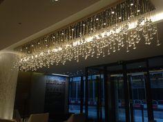 Cheval Three Quays: reception chandelier installed. Feb 2014