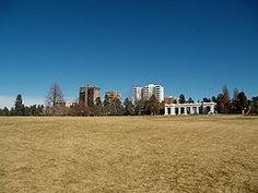 Cheesman Park in Denver, CO.  The expanse of lawn you are looking at is almost certainly the site of several occupied graves.  The park was a cemetary, and the contractor hired in 1893 to move the bodies didn't move ALL the bodies.  The neighborhood surrounding the park (some of it built on reclaimed cemetary) is said to be one of the most haunted in the US.  Links to Wiki's history of the park.