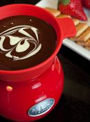 WORKED; Velata - Fun Fondue... My coworkers loved that we could place the warmed bag of chocolate in our work area and a couple of hours later they could still pour the silky chocolate from the bag. Even management was pleased we didn't have to plug anything in! Fondue anyone?!