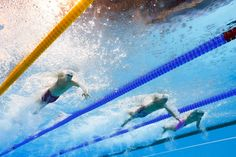 Canada's Yuri Kisil, left, swims during a men's 50-meter freestyle heat at the swimming competitions in the 2016 Summer Olympics in Rio de Janeiro, Brazil, Thursday, Aug. 11, 2016. (AP Photo/Lee Jin-man)