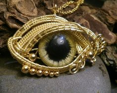 Gothic Steampunk Golden Evil Eye Pendant with Gold Beads Sold by Twistedsisterarts @ Etsy