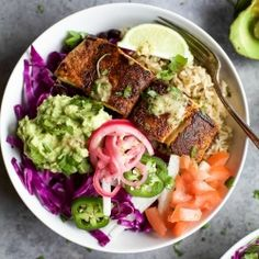 FISH TACO RICE BOWLS with avocado and pickled onions, topped with a Cilantro Lime Dressing! The perfect 30 minute meal to satisfy even the pickiest of eaters!