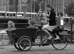 Typically Dutch: the 'bakfiets'. Mainly steered by mothers and Au Pairs and fully packed with kids, schoolbags and groceries. How do you solve transportation challenges? Kona Ute, Amsterdam Bike, Velo Cargo, Bike Style, Vintage Bicycles, Vintage Artwork, Vintage Photography, Old Photos, Netherlands