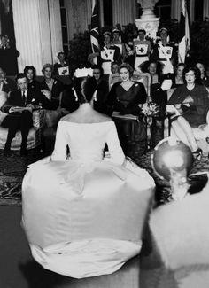 HRH Princess Margaret, front row, directly over the models right shoulder Yves St. Laurent
