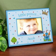"Little Prince Personalized Printed Baby Picture Frames. Your little prince will look like the King of the Castle with his handsome photo centered in this Personalized Little Prince Frame. This adorable Personalized Picture Frame makes a great gift for the Grandparents, Parents, Aunts & Uncles. Our Little Prince Printed Frame is available on our frame which measures 8"" x 10"" and holds a 3.5"" x 5"" or 4"" x 6"" photo. Easel back allows for desk display or ready for wall"