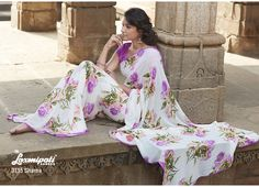 Look Gorgeously Feminine In This Beautifully violet flowers' prints  With Lace Saree.