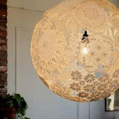 Lace lantern with wallpaper glue and doilies over a round balloon (Swedish craft idea!)