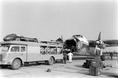OM Racing Car Transporter. Racing Cars being loaded into a Bristol Freighter