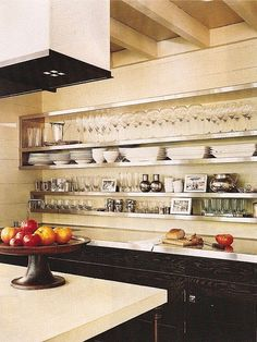 Digging the stainless steel counter tops and open shelves...wonder how durable they are...