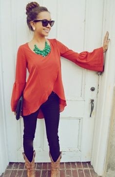 Coral blouse with turquoise chunky necklace, skinny jeans and boots- love!