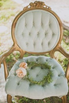 .Pretty frame on chair with touches of gold. TG