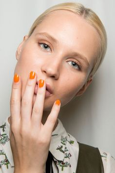 At Tibi S/S 2017 Jin Soon painted nails this bright tangerine color perfect for next Spring's season.