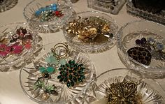 Jewelry stored in vintage condiment dishes....