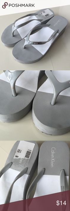 Calvin Klein foam wedge flip flops I've worn these once, they are a size too small. There are some marks and nicks on them, but pretty much new. Calvin Klein Shoes Sandals