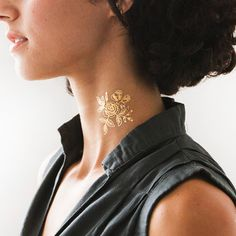 Swooning over these gold temporary tatts. http://go.brit.co/1NN4a6q