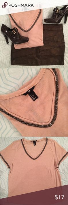 Pink tee with rhinestone trim H&M tee shirt with gun metal crystal trim on neckline and sleeves. Size Large. In excellent condition. H&M Tops Tees - Short Sleeve