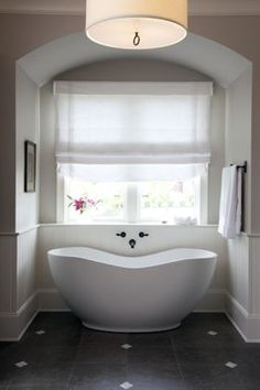 This tub shape is nice - would we wasn't plumbing on the outside wall though?