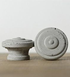 Replace boring ol' drawer or cabinet hardware with these concrete numbers. The knobs are designed in a classic round design with layered circles, and each one is cast by hand, giving them unique texture and air bubbles. They're solid concrete, giving any bathroom, kitchen or dresser drawer an industrial touch.