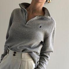 Grey waffled Ralph Lauren pullover top.