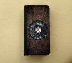 Rotary phone Case for iPhone 4 iPhone 5 by TreasuresByUs, $23.90. This is neat looking and holds a bit more than just a phone. You can store cards and money in there too!