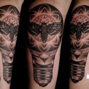 Moth in a lightbulb tattoo by David Rudzinksi