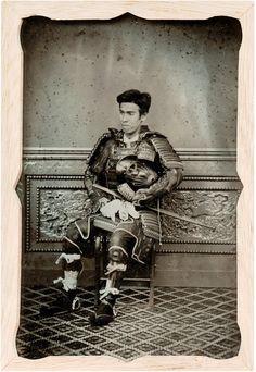 Portrait of a man in samurai armor, 1870s. Ambrotype in kiri wood case.