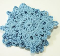 Granny square crochet coasters in blue eco organic fairtrade cotton by StitchedByAdele on Etsy