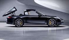 Porsche 911 Hard Top to Targa with the push of a button! Love the technology :-)