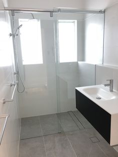 The frameless sliding shower screen offers you the versatility you need for your bathroom. Contact us for more information on our frameless shower screens. White Bathroom, Small Bathroom, Bathroom Ideas, Sliding Shower Screens, Sydney White, Shower Shelves, Frameless Shower, Built In Shelves, Bathtub