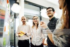 Business group standing close to whiteboard : Stock-Foto