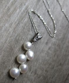 Classic white pearls, with a twist! This beautiful pearl pendant necklace is a modern spin on a timeless classic. Handmade by  Bethany Rose Designs. See more handcrafted jewelry at www.BethanyRoseDesigns.etsy.com