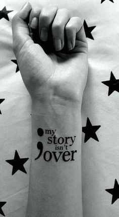 """This is one of the semicolon tattoo ideas that convey the symbol's meaning. The semicolon is imprinted on the wrist in plain black ink. It is big enough for the quote """"My story isn't over"""" to be printed on the right alongside it. All the imprints are in plain black. #tattoofriday #tattoos #tattooart #tattoodesign #tattooidea"""