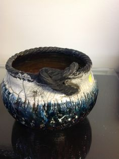 Clay creations by J&C.         Raku