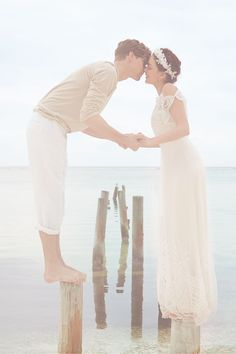 beautiful photo- sort of washed-out style lighting creates a dreamy effect...I may change that they are balancing on the old dock posts because hers goes under the bottom of her dress..and she doesn't look natural and comfortable..