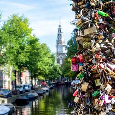 Locks on a bridge in the canals of Amsterdam. Photo courtesy of nodestinations on Instagram.