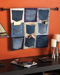 Combine cotton squares and rescued denim pockets to create a quilted wall hanging, the perfect storage place for all your phones, chargers, accessories, or as an entryway cache.
