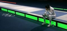 South Korean fencer Shin A Lam refuses to leave the piste as her team appeals her loss to German Britta Heidemann (via @ellievhall) #London2012 #Olympics