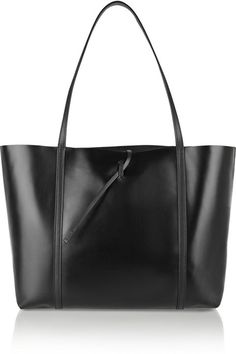 A bag that's polished enough for the office and useful for that massive grocery run? Sold! Kara Tie leather tote, $475, net-a-porter.com