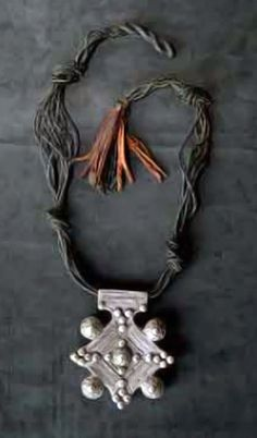 Morocco | Silver 'Southern Cross' pendant on braided leather cord | Est. 3,000 - 4,000 Dh (Mar. 08)