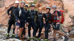 Seven hikers in safety helmets, wetsuits and climbing harnesses smiled for a group photo before heading into the mouth of a narrow desert canyon in southern Utah's Zion National Park.