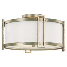Flush mount with a frosted glass diffuser.  Product: Flush mountConstruction Material: Steel, frosted glass and organzaColor: Winter goldFeatures:   UL listed for dry locationsTransitional style Accommodates: (3) 60 Watt medium base bulbs - not includedDimensions: 9.5'' H x 17'' Diameter